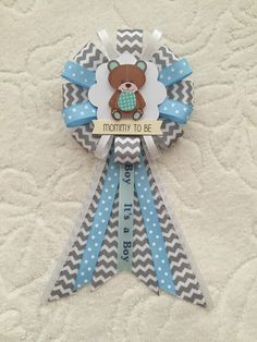 A personal favorite from my Etsy shop https://www.etsy.com/listing/472759639/mommy-to-be-ribbon-corsage-for-baby