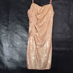 Hailey Logan NWT Gold Dress Stunning Gold shimmery prom/dance dress. Size large juniors. Brand new with tags. Great price. You'll be gorgeous in this dress!! Hailey Logan Dresses Strapless