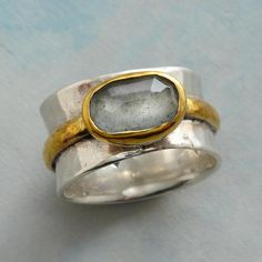 MOSS BANDEAU RING -- Wrapped around a concave sterling silver ring, is a slender band of brass bearing a faceted moss aquamarine. Exclusive. Whole sizes 5 to 10. Created by Nicole Ardis jewelry.