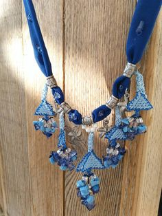 Just imagine you have it on your neck. Its as much eye catching as a diamond jewelry. Moreover it is a perfect gift. It is inevitable for the receiver not to get impressed.    This outstanding necklace is a real OOAK. Nowhere else found. Perfect harmony of needle lace, beads and chains. Mixed findings together with great color harmony.    Length adjustable via chainy clasp.    Ready to be shipped and will be packed carefully.    Do not wash or get wet.