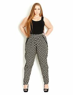 Slip into our Monotone Harem Pant for full fashion forward style. These lightweight pants feature a fitted waistband with demure pleats, 2 hip pockets, invisible side zip with hook and eye fastening and ruched detail at lower leg. sonsi.com