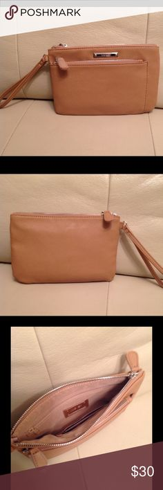 """NINE WEST - DK CAMEL COLOR - HANDBAG/WRISTLET Authentic New Nine West with a beautiful DK Camel Color Handbag/ wristlet. Has a second zipper packet in the outside front, practical for fitting any size phone. Measures 5.5""""h x 8.5""""w x 1/2""""d. Bags Clutches & Wristlets"""