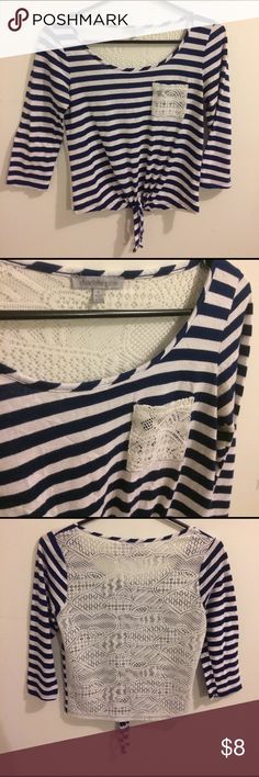 Lace Back Charlotte Russe Top Super Cute tie front Charlotte Russe Top Size Small. I've only worn it a few times so it's in good condition. Navy blue and white Stripped with a lace back and pocket. Feel free to make offers and ask questions :) Charlotte Russe Tops