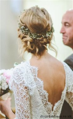 Sweet and 'messy' boho hairstyle. Love the simple floral wreath (not overdone). This very loose and simple hairstyle pairs beautifully with this gorgeous lace gown.