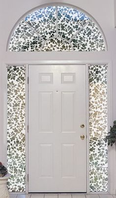 this white entrydoor gets lots of artistic help from the half circle transom window - Decorative Windows
