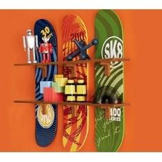 This is a great idea for old skate decks, & I've seen it with the decks used as the actual shelves as well.