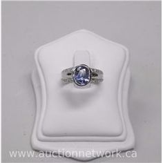 Ladies 18kt White Gold Diamond and Sapphire Ring. It Contains 1 Oval Faceted Sapphire (2.92ct) and 3 - Auction Network