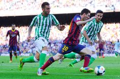 Lionel Messi of FC Barcelona duels for the ball with Jose Antonio Delgado 'Nono' (L) and Juan Carlos Perez 'Juankar' of Real Betis Balompie during the La Liga match between FC Barcelona and Real Betis Balompie at Camp Nou on April 5, 2014 in Barcelona, Catalonia.