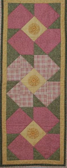 This fun table runner is a snap to put together and will add a bit of Summer to your kitchen table.