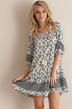 - Lightweight - Fully lined - Lace accents Size + Fit Model is wearing size S Fabric content 100% Rayon