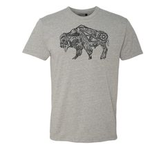 "The Roam Bison Premium T-Shirt by TASCO.  Roam if you want to...Roam around the World - The latest design by artist Skye Walker brings it all together for us, with the MTB as the backbone of our the adventure.  Whether it be mountain biking, fishing, surfing, camping, hiking, or just breathing fresh air, we love to show off our love for the outdoor life!  In order to make this a premium quality T-Shirt, we use a ""tagless"" ring spun combed cotton / polyester blend T-shirt as ou..."