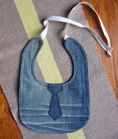 Handmade, backed in denim and finished with 9.5 inch white twill ties. Bib measures approximately 10 inches length and 8 inches width. $12.00