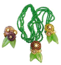 Hess lariat necklace of green glass leaves, brown and bugle beads and green beads, from the Hotel Roney Haskell boutique in Miami, Florida. A Frank Hess design for Miriam Haskell.