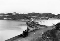 The Mulholland Dam holds back the Hollywood Reservoir in 1928, a few years after its construction...