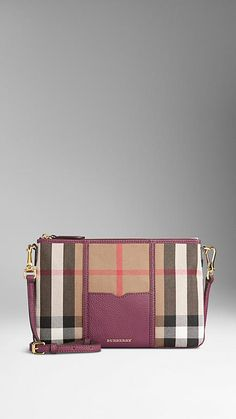 Elderberry House Check and Leather Clutch Bag from Burberry - House check cotton clutch bag with grainy leather panel. Top zip closure and detachable leather strap. Discover the women's bags collection at Burberry.com