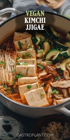 Vegan Kimchi Jjigae | A simple Korean-style stew made from kimchi, mushrooms, tofu, and assorted veggies. It has a comforting balance between sweet, sour, spicy, and savory and is one of my favorite cold-weather meals.
