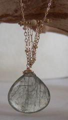 Garden Quartz Pendant ~ Green striations run through this sweet stone. Gold-filled chains and stardust beads add to its beauty.  $136.00 halliescomet.com