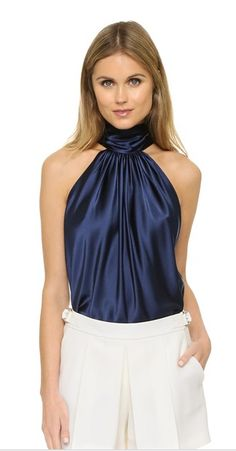aaccd26ad Silky satin fabric elevates the look of this stylish tank top. Skinny  strings tie at the back of the neck for a chic halter look