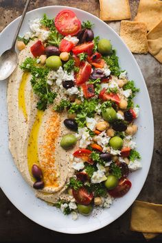 This Loaded Hummus is a great crowd-pleasing appetizer, but the hummus recipe itself is a keeper! Make this regularly and keep a container in the fridge! It's great for snacking, lunches and dinners. Naturally vegan and gluten-free. From healthy food Great Appetizers, Appetizer Recipes, Appetizer Ideas, Wedding Appetizers, Dinner Party Appetizers, Easy Summer Appetizers, Nibbles Ideas, Vegetable Appetizers, Holiday Appetizers