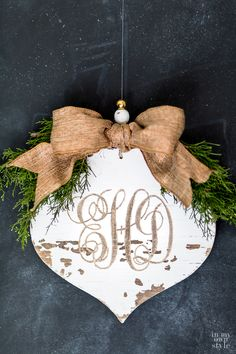 Carved monogram into a rustic wood Christmas ornament