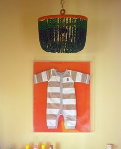 Little Green Notebook: Framing Baby and Vintage Clothing (Will do this w/ some of my fave baby clothes when we're done using them!)
