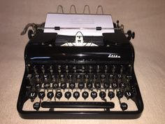 Mechanische Schreibmaschine Optima Elite portable typewriter um 1953