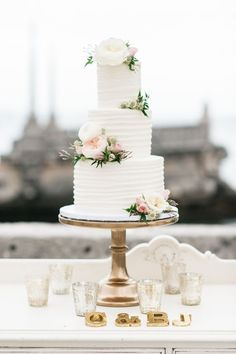 Enchanting white cake with Juliet roses.