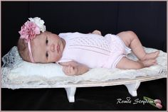 wow....this is a reborn baby doll..she is made of solid silicone..how realistic!!