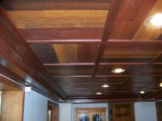 "Ceiling: ""Our customer had seen laminate flooring creatively used as a wall covering... the ceiling panels are made from three different colors of laminate flooring and set in a pinwheel pattern."""