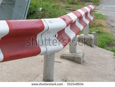 Rusted guardrail White - red zone no parking - stock photo
