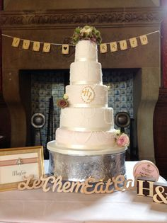 Vintage 5 tier wedding cake with draped pearls and real roses. Wedding cakes London, Hertfordshire, Essex and Kent.