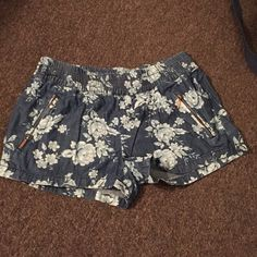 Floral Denim Shorts Floral Denim Lightweight Shorts. Zippers on side. Elastic waist band. Waist band to bottom of short is 10 inches. Inseam is about 2.5. Love Fire Shorts Jean Shorts