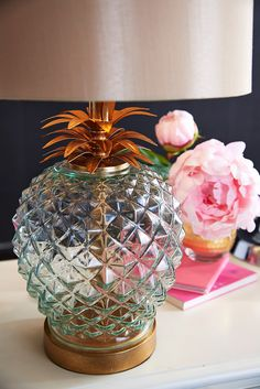 Introduced in Europe in 1493, pineapple was served only by affluent hosts who could afford it. In turn, the fruit became a symbol of generosity, hospitality and, of course, wealth. Create a sense of welcome in your home with Pier 1's Regal Pineapple Lamp trimmed in golden steel. And the best part? You won't need to spend a fortune to bring this symbol of warmth into your home.