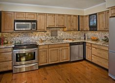 """Kitchen Cabinet Refacing: Hardwood sugar maple with a light """"Bamboo"""" finish and a hand applied """"Black"""" glaze rub. Accents painted in """"Antique Slate""""."""