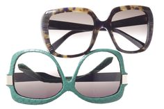Linda Farrow Luxe's acetate sunglasses with python-skin wrapping.