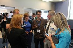 #CERNTweetup tweeps talking with Maurice Bourquin in the AMS control room (POCC)   (credit: ESA)