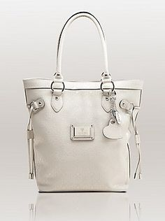 This Guess white tote is one of my favorite handbags of all time. It's a great material so it doesn't get dirty & it's super strong- it seems like it's indestructible lol. Love GUESS handbags! ❤