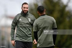 VINOVO, ITALY - APRIL 02: Gonzalo Higuain and Douglas Costa of Juventus during the Champions League training session at Juventus Center Vinovo on April 2, 2018 in Vinovo, Italy. (Photo by Daniele Badolato - Juventus FC/Juventus FC via Getty Images)