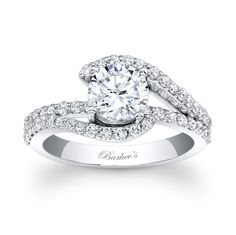 Unique Engagement Ring - 7848LW - This classic, elegant white gold diamond engagement ring features a prong set round diamond center.  The split shank is adorned with  shared prong set diamonds, and the shoulders cathedral up and curve to cradle the center at the sides, while a diamond bridge runs through the center.