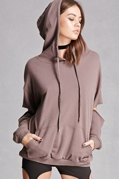 A French terry knit sweatshirt featuring a drawstring hood, a front kangaroo pocket, dropped shoulders, long sleeves with cutouts at the elbows, and ribbed trim. This is an independent brand and not a Forever 21 branded item.