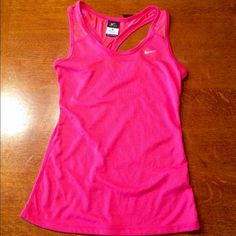 Women's Nike dri fit tank. Very cute pink Nike dri fit women's tank.  Women's size XS. Cute detail to back of tank. 85% polyester and 15% cotton. Has been worn a couple of times but is in brand new condition. Nike Tops Tank Tops