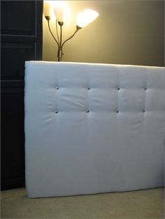 #headboard We made one similar to this for my daughter. Got a cheap piece of plywood, batting, fabulous fabric (off clearance) and staple gun.