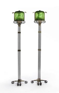 A pair of Crest parcel gilt wrought iron and Steuben molded green glass torcheres designed by E. G. Blumenfeld, 1929