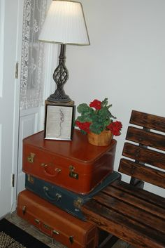 old suitcases turned into a corner table...
