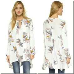 Free People Tree Floral Swing Top Tunic XS A breezy Free People top in a relaxed fit. A pretty floral print and embroidery on the sleeves add feminine touches. A front keyhole is secured with a single button at the neckline. Long sleeves. Fabric: Crepe. 100% rayon. Wash cold or dry clean. Imported, China. Measurements Length: 28.25in / 72cm, from shoulder Measurements from size S. Color: Pearl Combo  New with tags. Perfect condition. Color is a very pale pink. Free People Tops Tunics