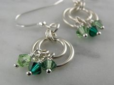 Items similar to Sterling Silver Double Circle Earrings with Green Crystals on Etsy