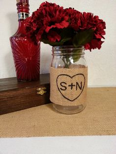 custom burlap mason jar wedding centerpiece rustic wedding decor. $7.00, via Etsy.http://www.etsy.com/listing/116786692/custom-burlap-mason-jar-wedding?ref=sr_gallery_19_search_query=wedding+centerpiece_order=most_relevant_view_type=gallery_ship_to=US_page=11_search_type=all
