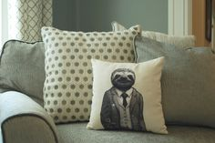 Make any living space fun and classy with this Stylish Sloth pillow. His superb attire is sure to spark an engaging conversation and win the hearts of your guests. No one can resist cuddling this lovable piece!  The Stylish Sloth image is original art by artist and shop owner Michael Phipps. The sloth appears on the front side of the pillow and the reverse is blank. The pillow color is cream. 14 x 14 inch (35 x 35 cm), arrives stuffed and sewn shut. See other unique items in our shop home…
