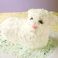 "Easter Lamb Cake | ""This white cake is baked in a lamb mold for Easter and can be decorated to look like a little lamb. If desired, spices can be added just before adding the egg whites. Some good choices are anise, nutmeg or cinnamon."""