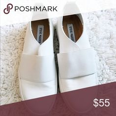 Steve Madden white sneakers Steve Madden white leather slip on sneakers. never been worn out of the house. Steve Madden Shoes Sneakers